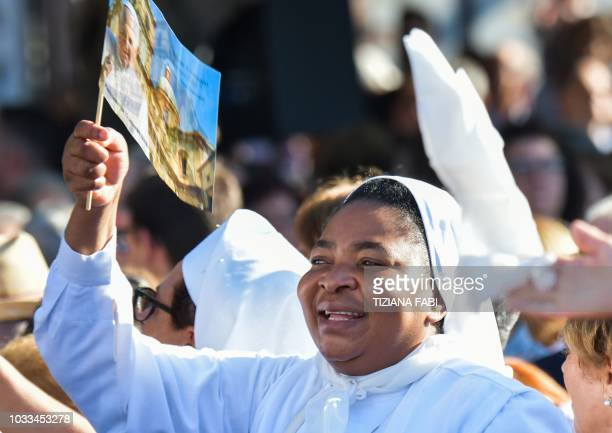 A nun reacts as the Pope delivers a speech to the faithful gathered on Piazza Europa in Piazza Armerina central Sicily on September 15 2018 Pope...
