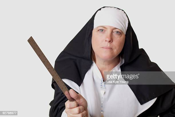 nun ready to smack you with ruler - nun with ruler stock pictures, royalty-free photos & images