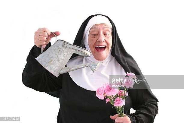 nun series flower garden - nun stock photos and pictures