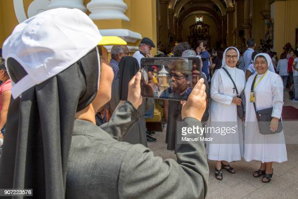 A nun takes photos in the entrance of Trujillo Cathedral during Pope Francis 4day apostolic visit to Peru on January 19 2018 in Trujillo Peru