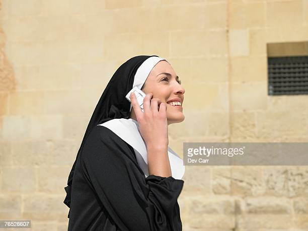 Nun talking on mobile phone smiling, Alicante, Spain,