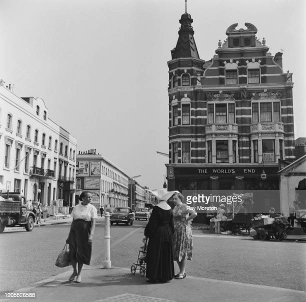 A nun talking to a woman on the King's Road near The World's End pub in Chelsea London September 1959