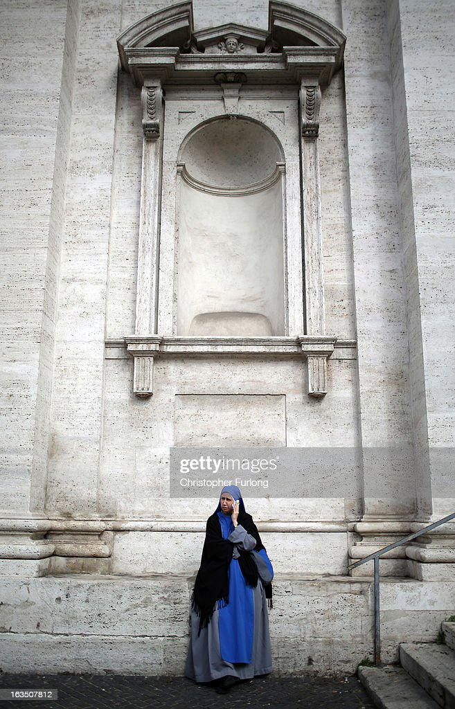 A nun talks on her telephone outside a church as cardinals prepare to elect a new Pope, on March 11, 2013 in Rome, Italy. Cardinals are set to enter the conclave to elect a successor to Pope Benedict XVI after he became the first pope in 600 years to resign from the role. The conclave is scheduled to start on March 12 inside the Sistine Chapel and will be attended by 115 cardinals as they vote to select the 266th Pope of the Catholic Church.