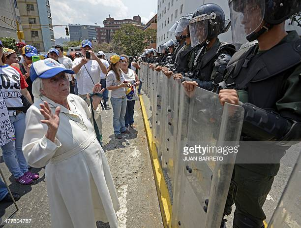 A nun talks with members of the national guard during a protest against the government of Venezuelan President Nicolas Maduro in Caracas on March 8...