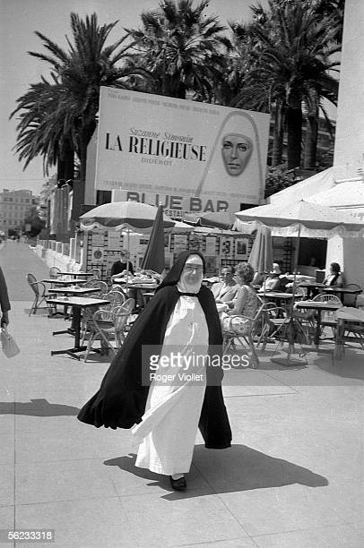 A nun under the look of Anna Karina top top of the bill of 'The Nun' by Jacques Rivette Cannes Film Festival 1966 HA191340