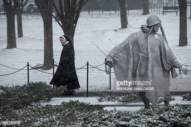 A nun visits the Korean War Memorial January 21 2014 in Washington DC The northeastern United States hunkered down Tuesday for a major snowstorm that...