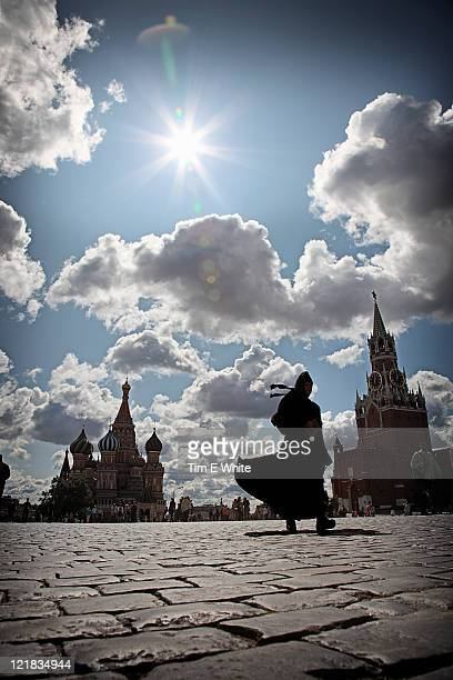 Nun walking across Red Square with the Kremlin in the Background,  Moscow, Russia