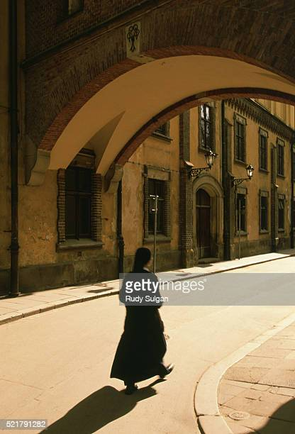 nun walking in old town - nun stock pictures, royalty-free photos & images