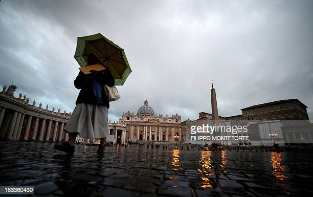 A nun walks in Saint Peter's Square at the Vatican on March 82013 The conclave to elect the next pope will start on March 12 the Vatican announced...