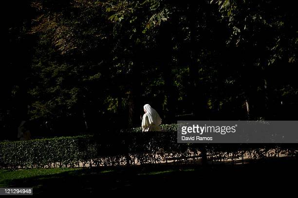 A nun walks on the Buen Retiro Park during the World Youth Day 2011 on August 17 2011 in Madrid Spain Initiated by Pope John Paul II in 1985 World...