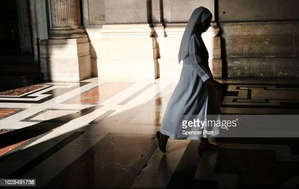 A nun walks through St Peter's Basilica on August 31 2018 in Vatican City Vatican Tensions in the Vatican are high following accusations that Pope...