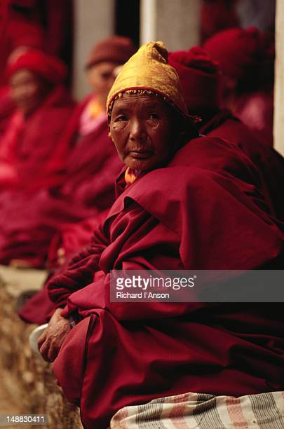 a nun watching the dancing at the mani rimdu festival at chiwang gompa (monastery). - mani rimdu festival stock pictures, royalty-free photos & images