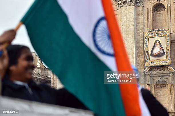 Nun waves the flag of the Indian state of Kerala, prior to a canonization mass for Indian priest Kuriakose Elias Chavara, and Indian Carmelite nun...