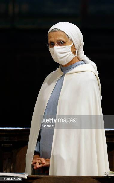 A nun wearing a protective face mask attends an All Saints Day mass led by Archbishop of Paris Michel Aupetit at the SaintGervaisSaintProtais church...