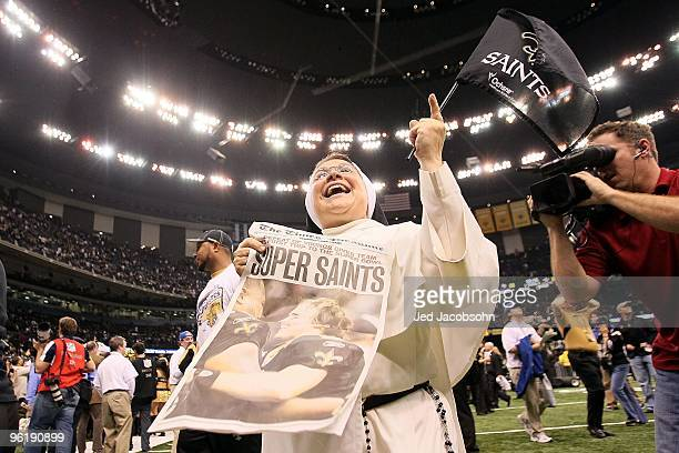 A nun who is a fan of the New Orleans Saints celebrates after the her team's 3128 overtime win against the Minnesota Vikings during the NFC...