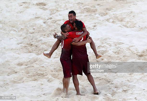 Nuno Belchior, Bernardo Santos and Rui Coimbra of Portugal celebrate during the Men's Beach Soccer Group A match between Portugal and Ukraine on day...