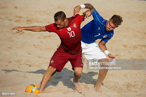 Nuno Belchior of Portugal competes for the ball with Dario Ramacciottii of Italy during the FIFA Beach Soccer World Cup 2017 Qualifier Europe Jesolo...