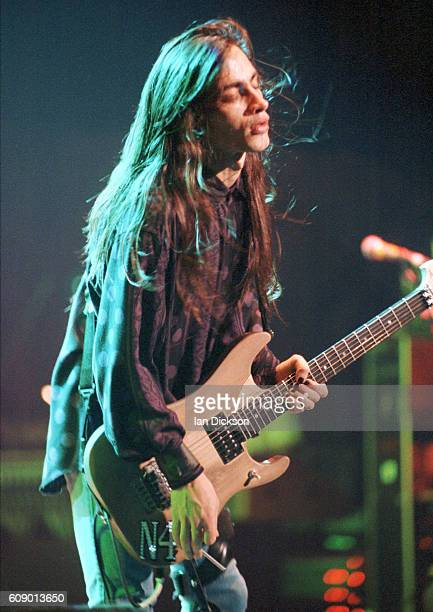 Nuno Bettencourt of Extreme performing on stage at Wembley Stadium London 18 July 1992