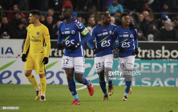 Nuno Da Costa of Strasbourg celebrate his goal with Ernest Seka and Kader Mangane Yuri Berchiche of PSG is disapointed during the Ligue 1 match...