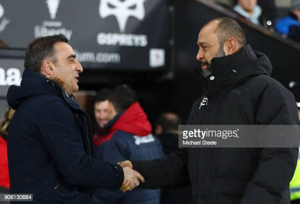 Nuno Espirito Santo and Carlos Carvalhal manager of Swansea City shake hands during The Emirates FA Cup Third Round Replay between Swansea City and...