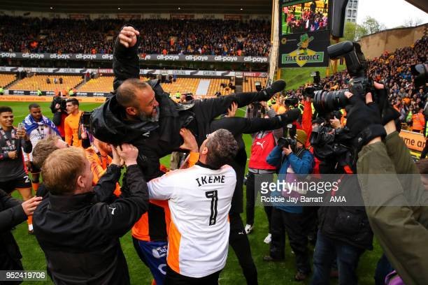 Nuno Espirito Santo head coach / manager of Wolverhampton Wanderers is thrown in the air by Wolverhampton Wanderers players and staff during the Sky...