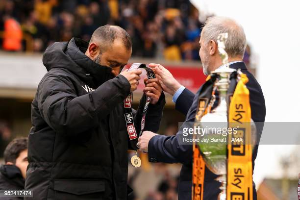 Nuno Espirito Santo head coach / manager of Wolverhampton Wanderers receives his winners medal during the Sky Bet Championship match between...