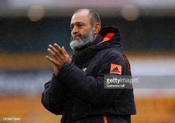 Nuno Espirito Santo Manager of Wolverhampton Wanderers acknowledges with the fans after his last Premier League match between Wolverhampton Wanderers...