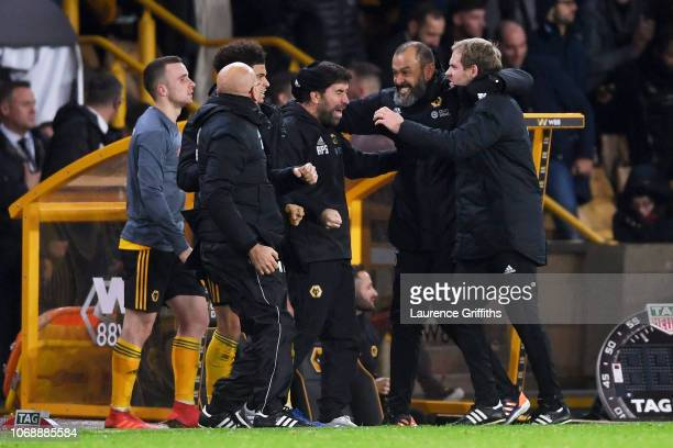 Nuno Espirito Santo Manager of Wolverhampton Wanderers and his backroom staff celebrate following their sides victory in the Premier League match...