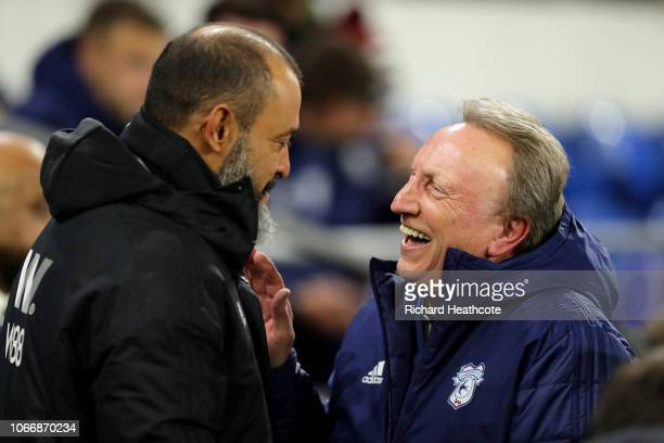 Nuno Espirito Santo Manager of Wolverhampton Wanderers and Neil Warnock Manager of Cardiff City shake hands during the Premier League match between...
