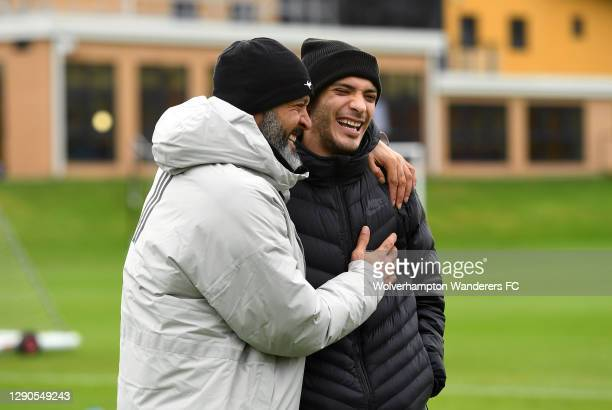 Nuno Espirito Santo, Manager of Wolverhampton Wanderers and Raul Jimenez of Wolverhampton Wanderers laugh and embrace during a training session at...
