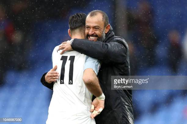 Nuno Espirito Santo, Manager of Wolverhampton Wanderers and Rui Patricio of Wolverhampton Wanderers celebrate following their sides victory in during...
