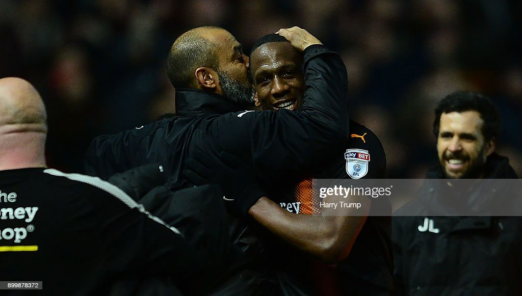 Nuno Espirito Santo, Manager of Wolverhampton Wanderers celebrates at the final whistle by kissing Willy Boly of Wolves(2R) during the Sky Bet Championship match between Bristol City and Wolverhampton Wanderers at Ashton Gate on December 30, 2017 in Bristol, England.