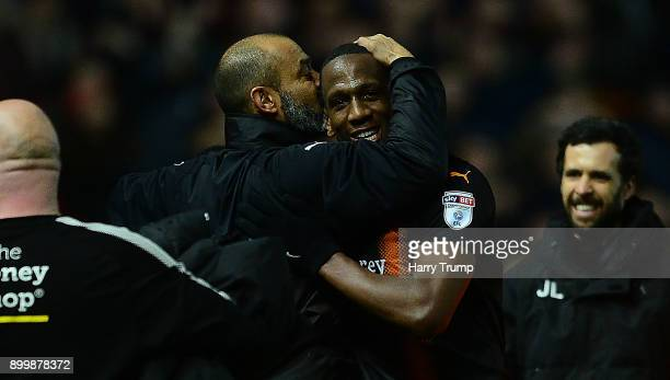 Nuno Espirito Santo Manager of Wolverhampton Wanderers celebrates at the final whistle by kissing Willy Boly of Wolves during the Sky Bet...