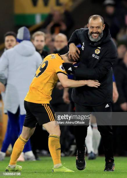 Nuno Espirito Santo manager of Wolverhampton Wanderers celebrates with Ruben Vinagre after the win during the Premier League match between...