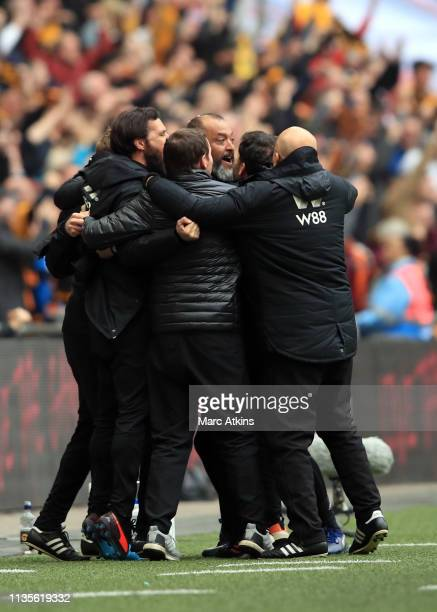 Nuno Espirito Santo manager of Wolverhampton Wanderers celebrates with his coaching staff during the FA Cup Semi Final match between Watford and...