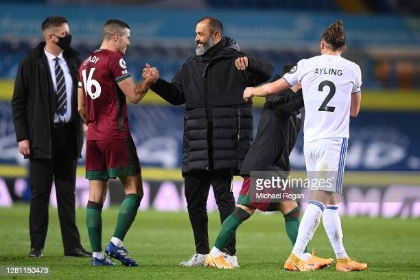 Nuno Espirito Santo Manager of Wolverhampton Wanderers celebrates with Conor Coady of Wolverhampton Wanderers at fulltime after the Premier League...