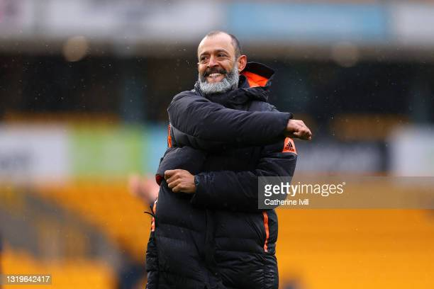 Nuno Espirito Santo, Manager of Wolverhampton Wanderers celebrates with the fans after his last match following the Premier League match between...