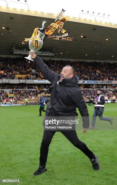 Nuno Espirito Santo Manager of Wolverhampton Wanderers celebrates with the Sky Bet Championship trophy following the Sky Bet Championship match...