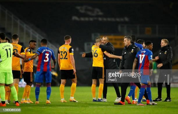 Nuno Espirito Santo Manager of Wolverhampton Wanderers embraces Conor Coady of Wolverhampton Wanderers following the Premier League match between...