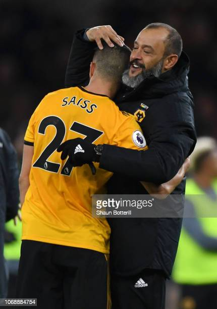 Nuno Espirito Santo Manager of Wolverhampton Wanderers embraces Romain Saiss of Wolverhampton Wanderers after the Premier League match between...
