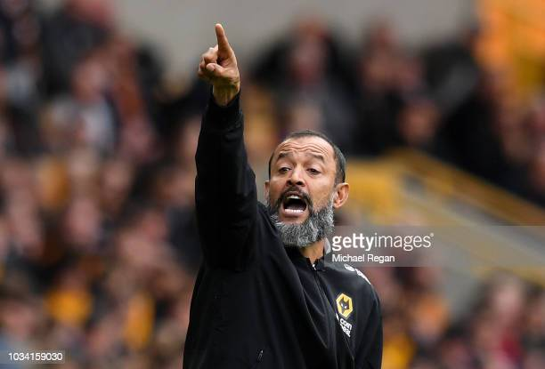 Nuno Espirito Santo Manager of Wolverhampton Wanderers gives his team instructions during the Premier League match between Wolverhampton Wanderers...