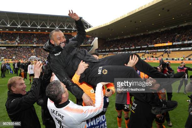 Nuno Espirito Santo Manager of Wolverhampton Wanderers is carried across the pitch after winning the Sky Bet Championship during the Sky Bet...
