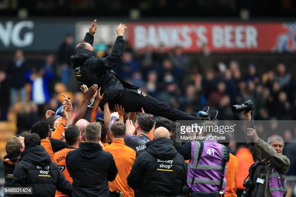 Nuno Espirito Santo manager of Wolverhampton Wanderers is thrown into the air by his players during the Sky Bet Championship match between...