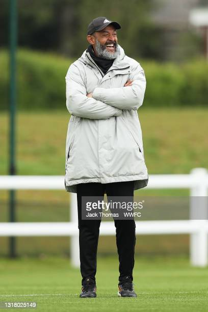Nuno Espirito Santo, Manager of Wolverhampton Wanderers looks on during a Wolverhampton Wanderers Training Session at Sir Jack Hayward Training...