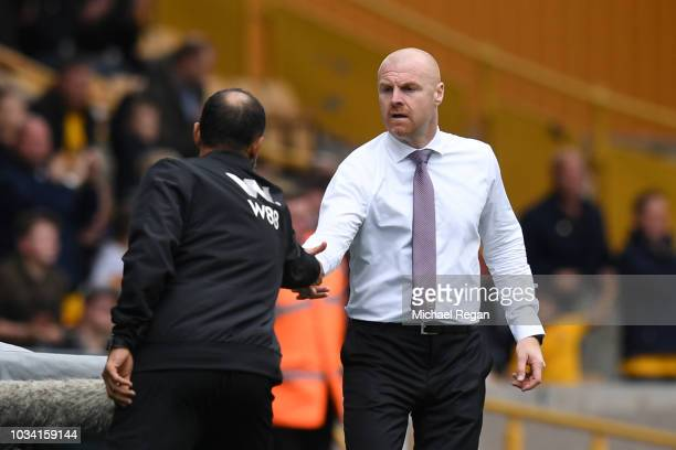 Nuno Espirito Santo Manager of Wolverhampton Wanderers shakes hands with Sean Dyche Manager of Burnley after the Premier League match between...