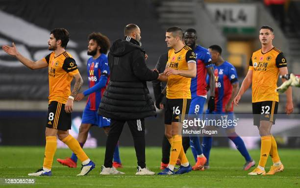 Nuno Espirito Santo Manager of Wolverhampton Wanderers shakes hands with Conor Coady of Wolverhampton Wanderers following the Premier League match...