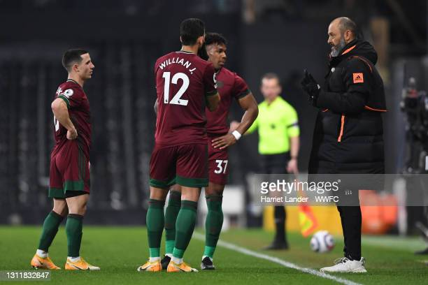 Nuno Espirito Santo, Manager of Wolverhampton Wanderers speaks with Willian Jose, Adama Traore and Daniel Podence during the Premier League match...