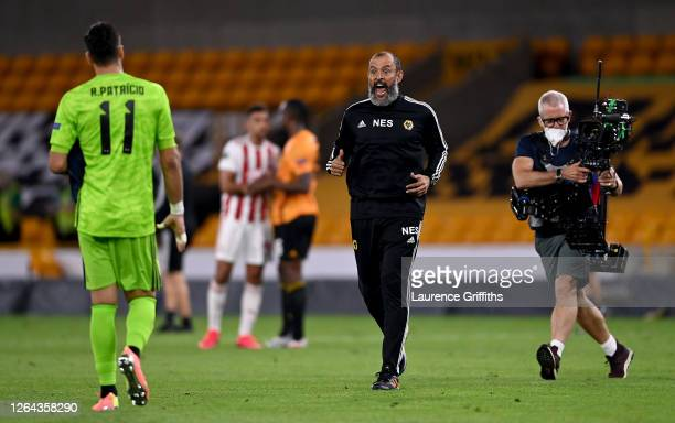 Nuno Espirito Santo Manager of Wolves celebrates victory with Rui Patricio during the UEFA Europa League round of 16 second leg match between...