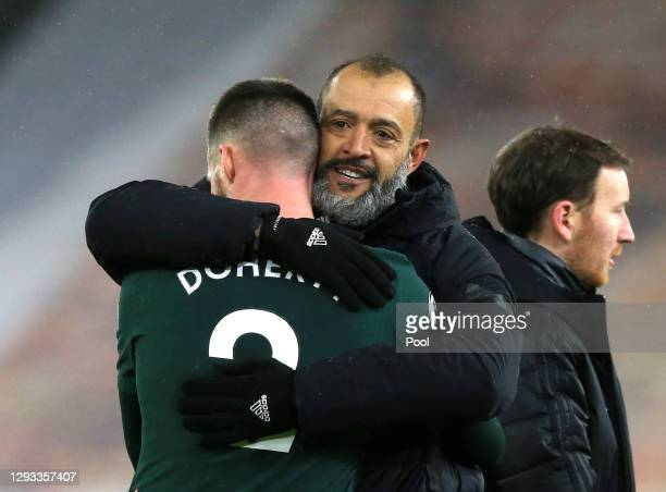 Nuno Espirito Santo, Manager of Wolves embraces Matt Doherty of Tottenham Hotspur after the Premier League match between Wolverhampton Wanderers and...