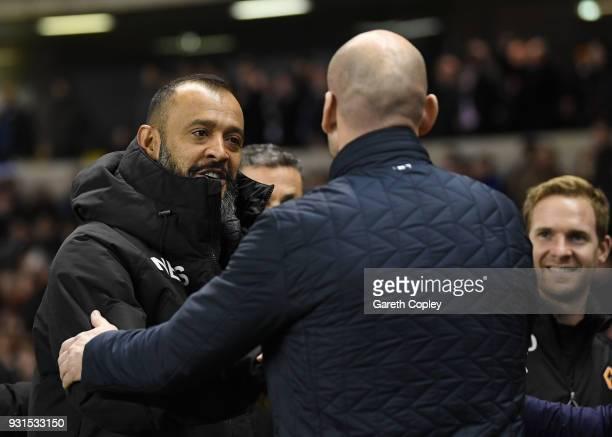 Nuno Espirito Santo of Wolverhampton Wanderers greets Jaap Stam of Reading prior to the Sky Bet Championship match between Wolverhampton Wanderers...